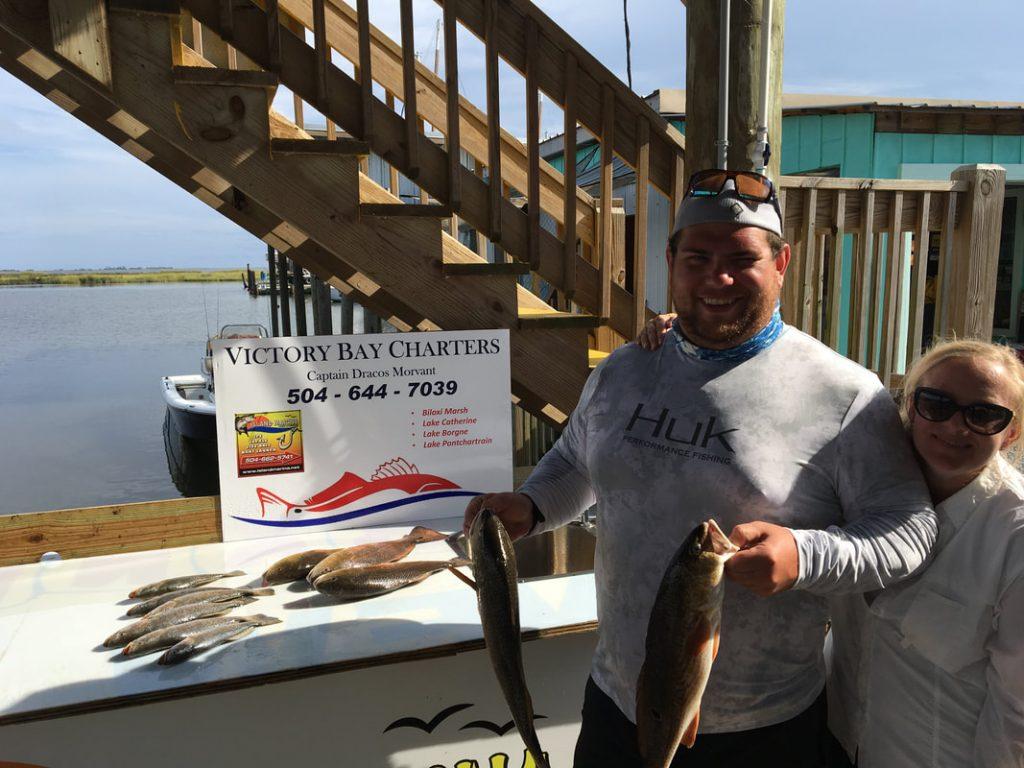 Phil and Lauren enjoying charter fishing in Louisiana Marshes