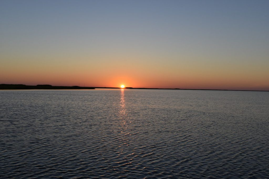 view of the sunset over the lake in new orleans