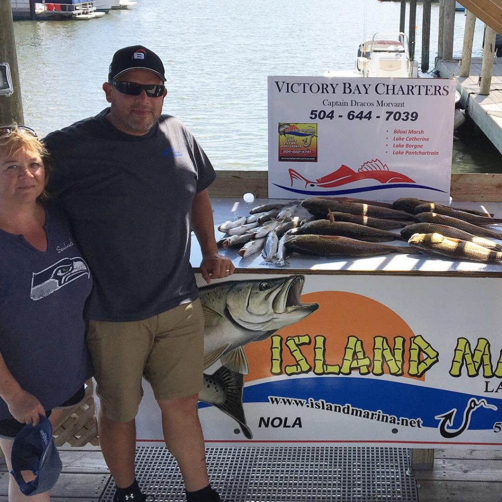 Fred and Lisa Redfish Charter fishing in Lake Catherine