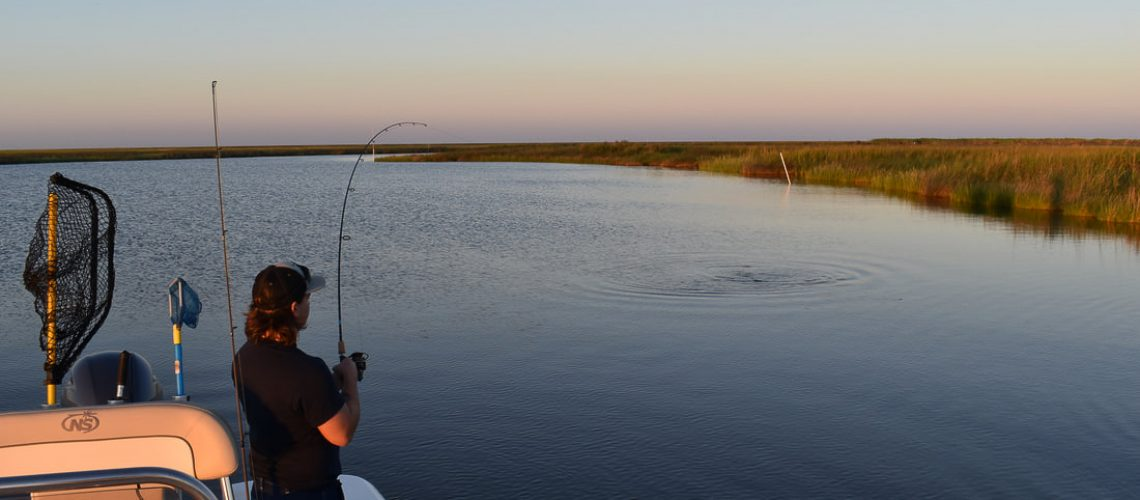 Mathew fishing for Jack redfish in Lake Catherine
