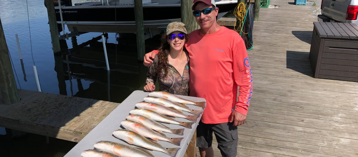 couple with fish that were caught with Victory Bay charters